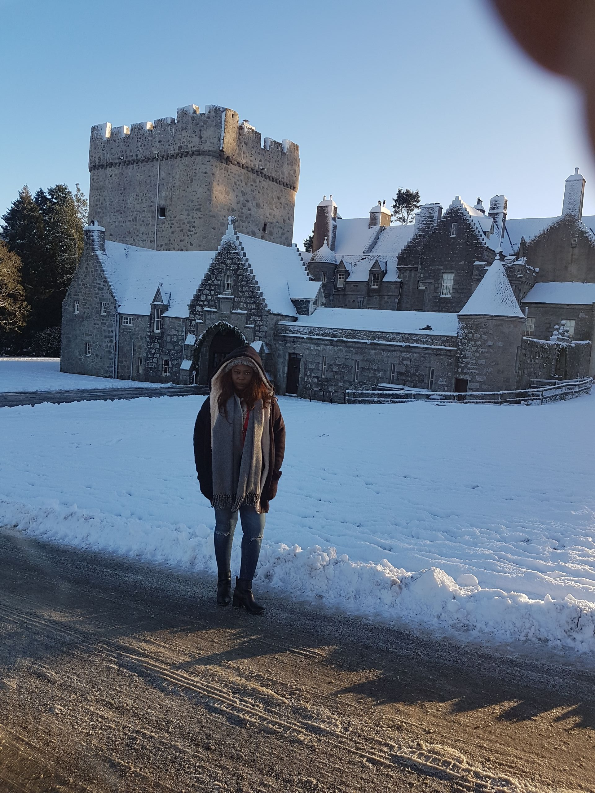 Lady in front of a castle