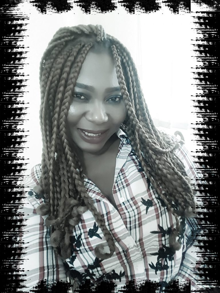 lady wearing colorful African braids