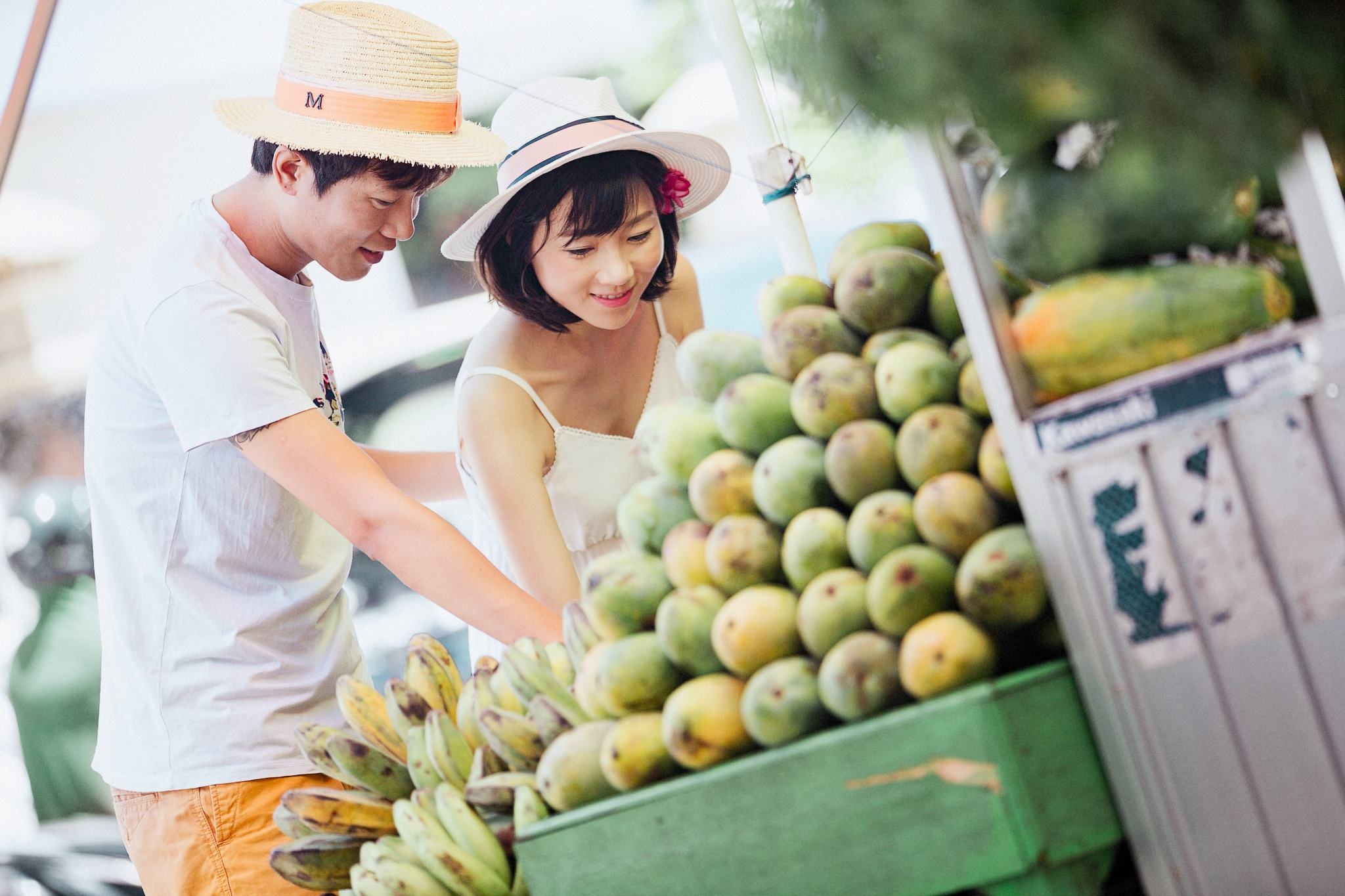 Picture of a man and woman admiring fruits in a fruit stand