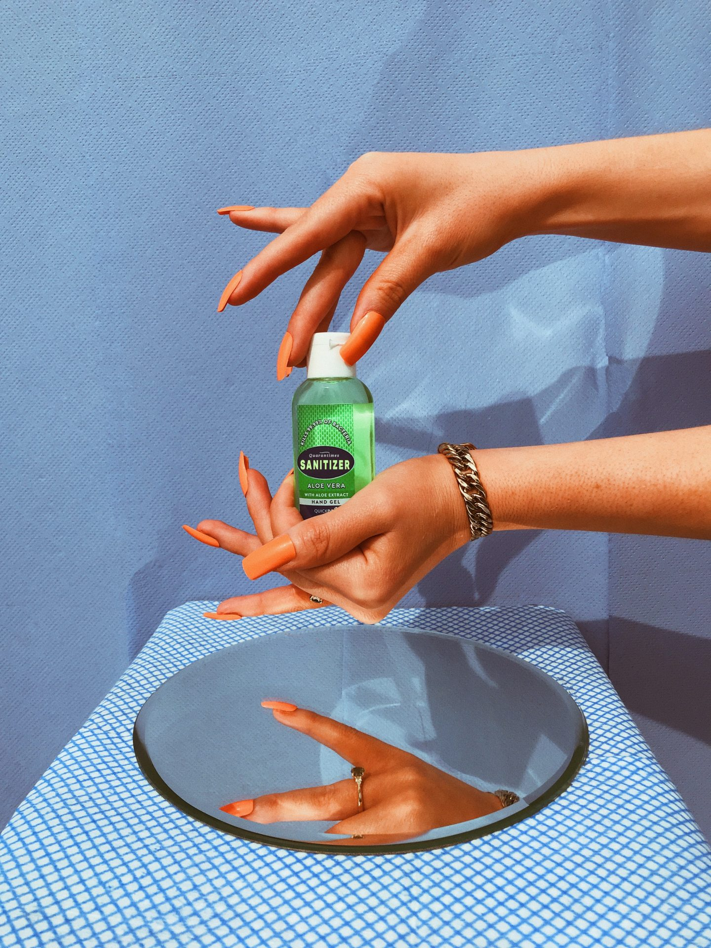 lady washing hands with hand sanitizer to stop the spread of the coronavirus
