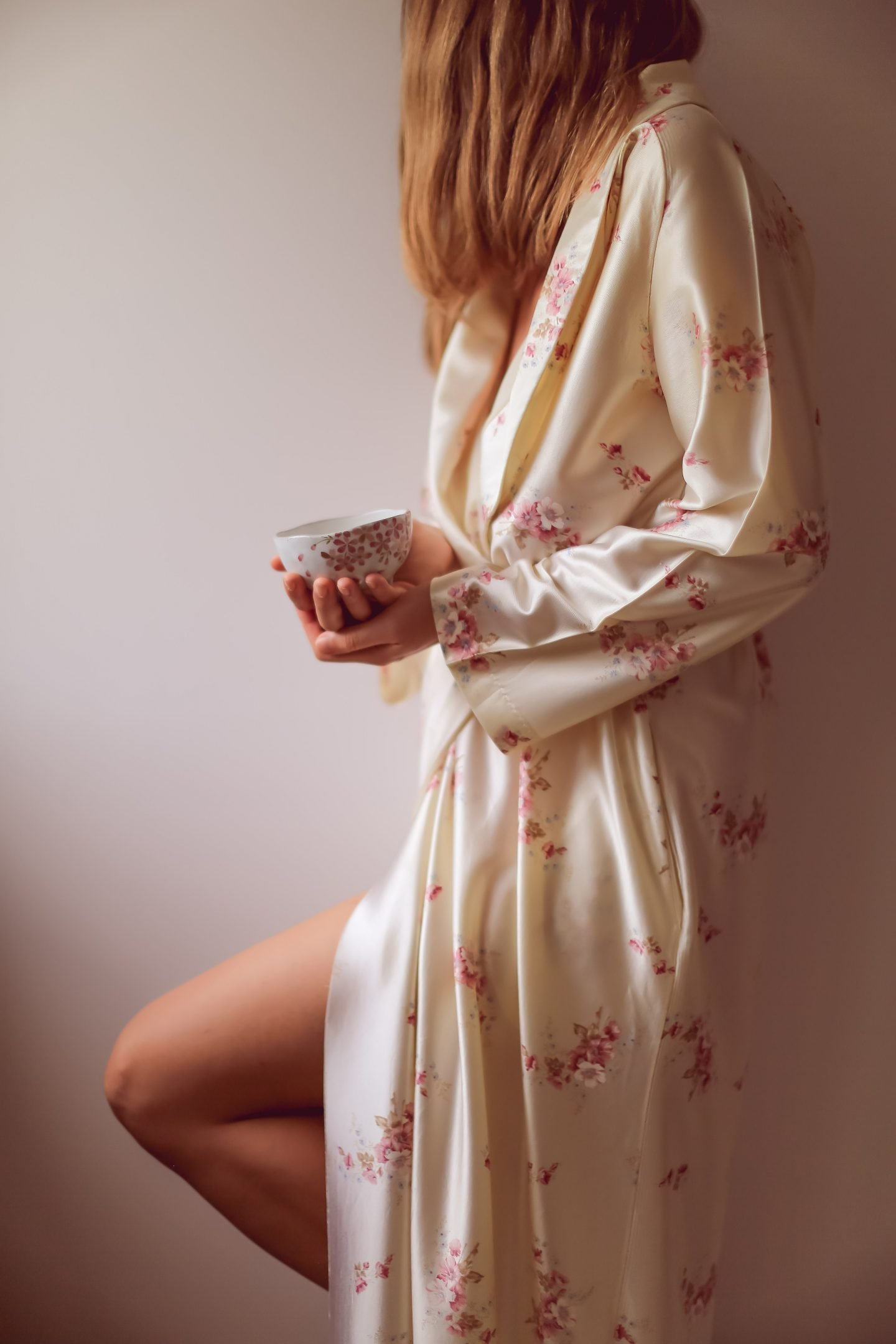 Woman in a robe practicing self care