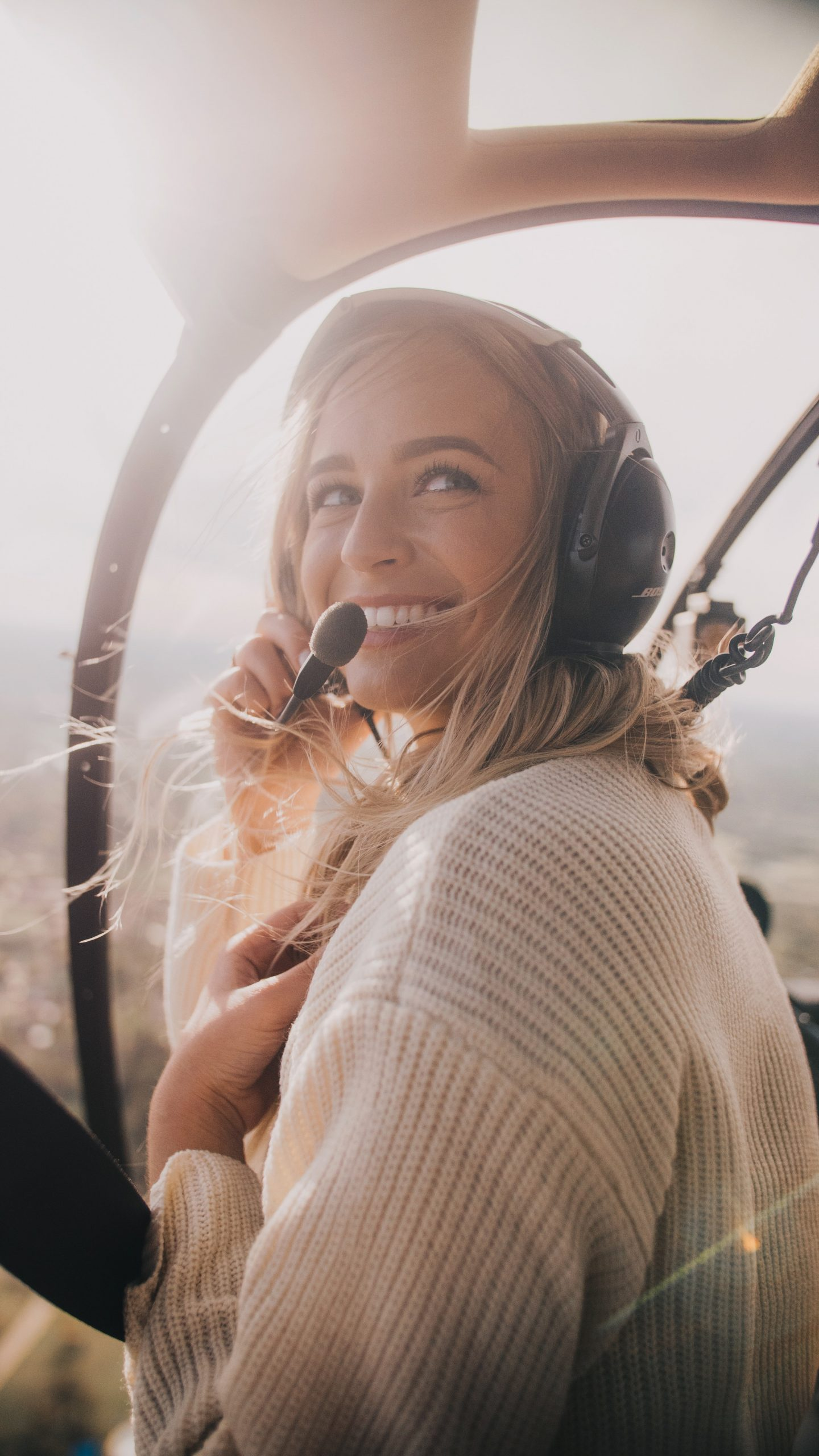 Smiling Woman flying a helicopter