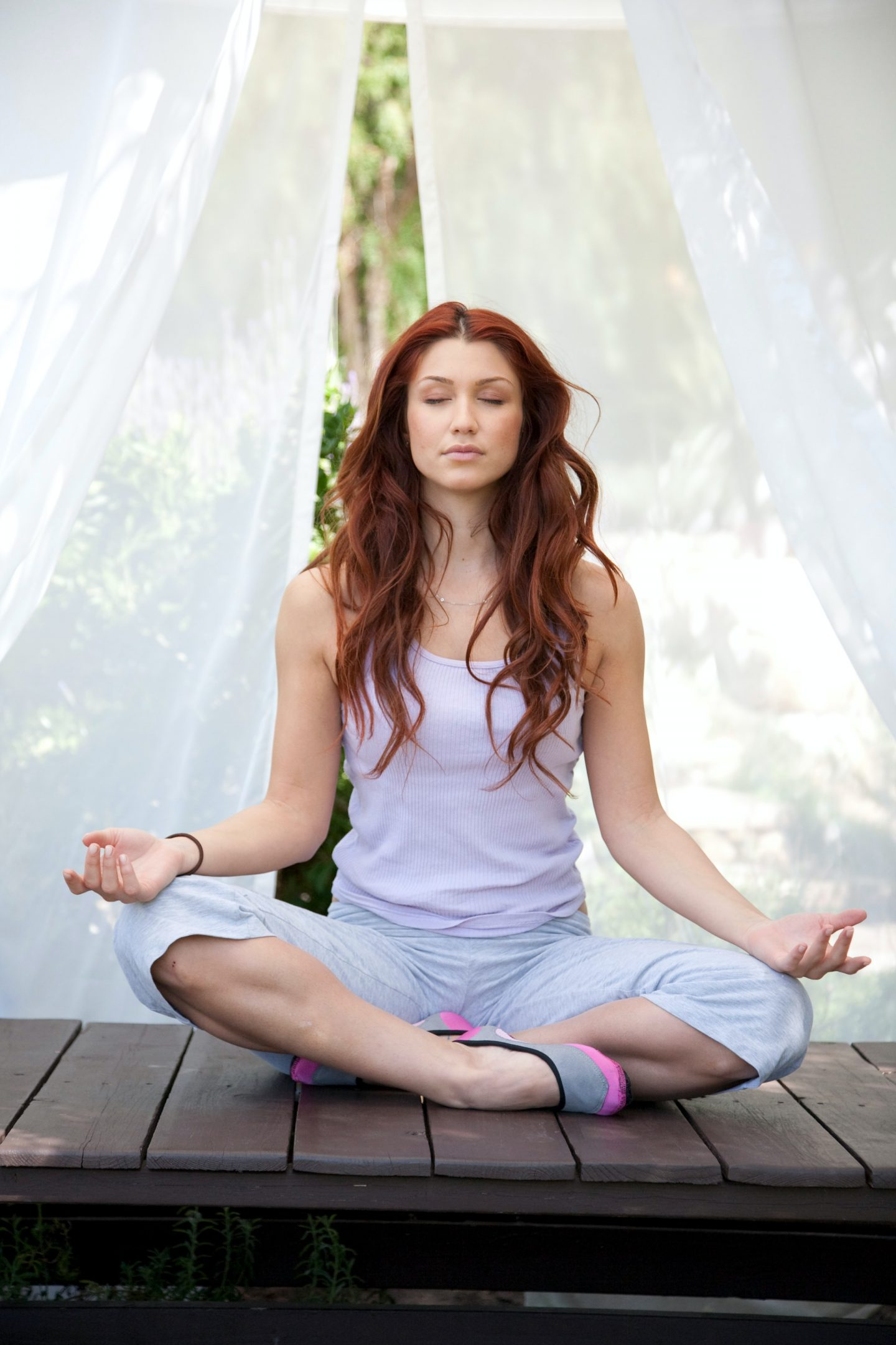 Woman meditating as part of her self care activities