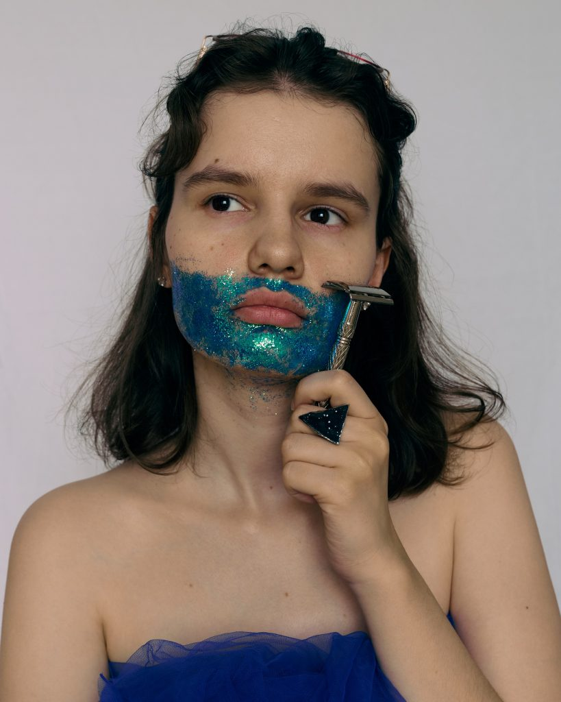 Woman holding a shaving stick to her chin